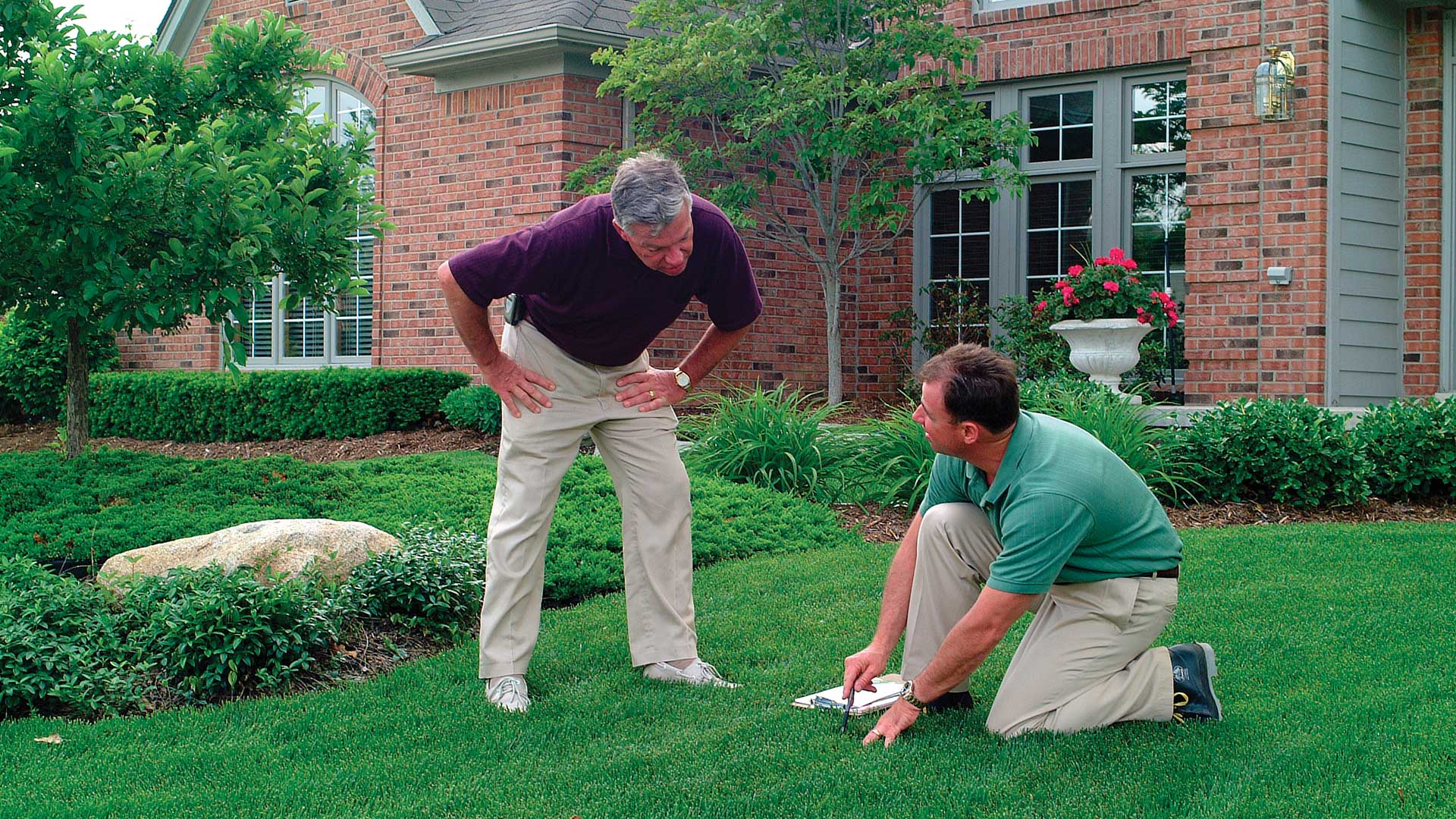 The Lawn Techs discussing a lawn treatment program with a customer in Berkeley Heights, NJ.